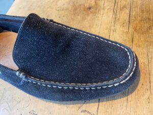 Finished blue suede shoe